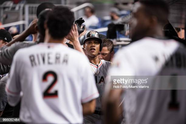 Starlin Castro of the Miami Marlins celebrates in the dugout after hitting a home run during the game against the Milwaukee Brewers at Marlins Park...