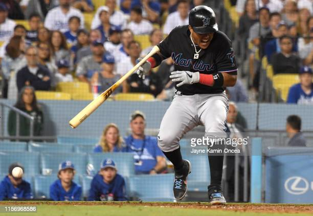 Starlin Castro of the Miami Marlins drops his bat after he was hit by a pitch in the eighth inning of the game against the Los Angeles Dodgers at...