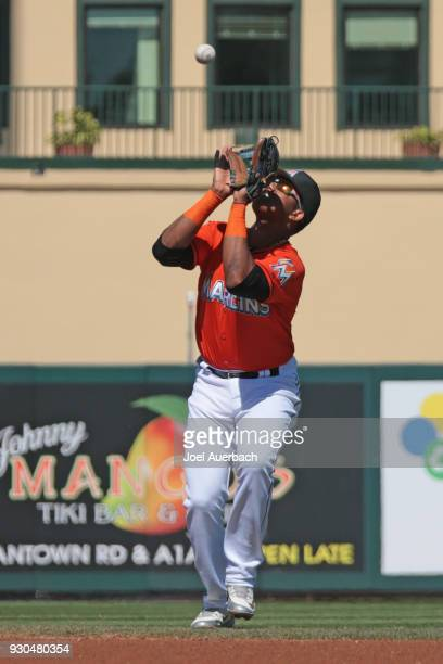 Starlin Castro of the Miami Marlins fields the ball hit by Christian Vazquez of the Boston Red Sox during a spring training game at Roger Dean...
