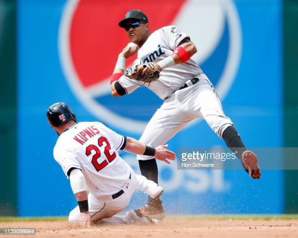 Starlin Castro of the Miami Marlins forces out Jason Kipnis of the Cleveland Indians at second base during the fourth inning at Progressive Field on...