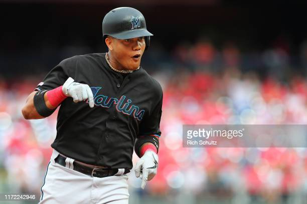 Starlin Castro of the Miami Marlins gestures as he rounds the basses after hitting a home run against the Philadelphia Phillies during the second...