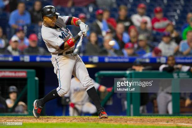 Starlin Castro of the Miami Marlins hits a two run home run in the top of the tenth inning against the Philadelphia Phillies at Citizens Bank Park on...