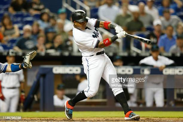 Starlin Castro of the Miami Marlins hits an RBI single in the sixth inning against the New York Mets at Marlins Park on April 01 2019 in Miami Florida