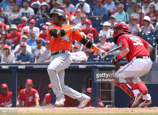 Starlin Castro of the Miami Marlins hits the ball against the Washington Nationals during a spring training game at The Ballpark of the Palm Beaches...