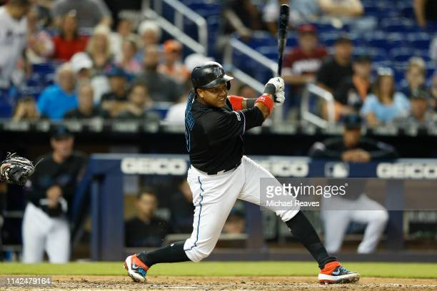Starlin Castro of the Miami Marlins in action against the Philadelphia Phillies at Marlins Park on April 12 2019 in Miami Florida