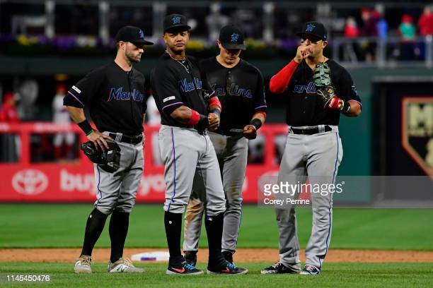 Starlin Castro of the Miami Marlins looks on with other infielders during a pitching rotation during the eighth inning at Citizens Bank Park on April...