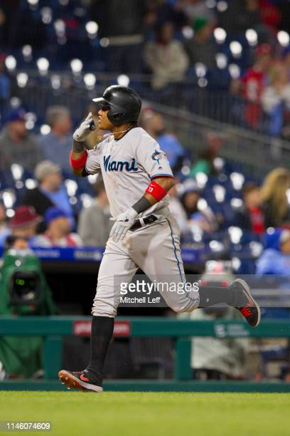 Starlin Castro of the Miami Marlins rounds the bases after hitting a two run home run in the top of the tenth inning against the Philadelphia...
