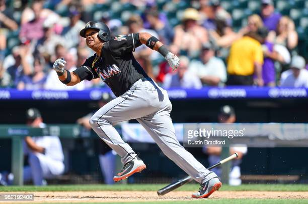 Starlin Castro of the Miami Marlins runs for an infield single in the seventh inning of a game against the Colorado Rockies at Coors Field on June 23...