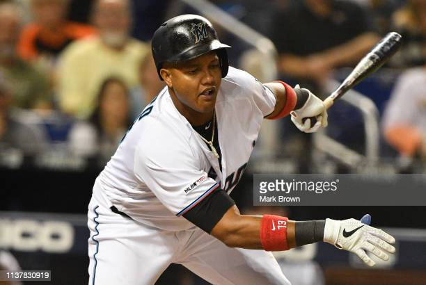 Starlin Castro of the Miami Marlins strikes out with the bases loaded in the seventh inning against the Chicago Cubs at Marlins Park on April 17 2019...