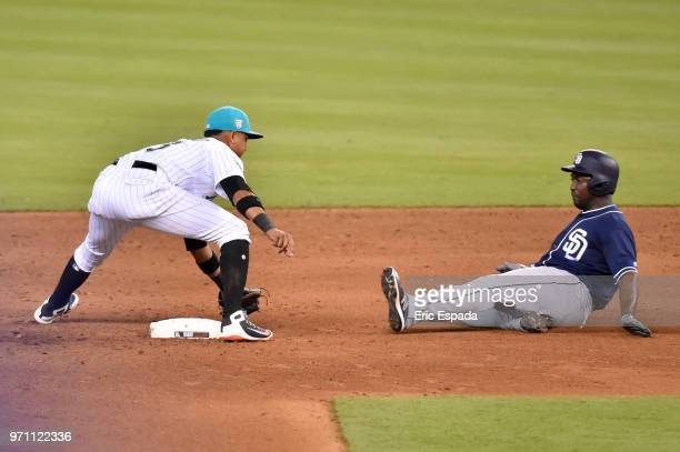 Starlin Castro of the Miami Marlins tags out Jose Pirela of the San Diego Padres at second base during the sixth inning of the game at Marlins Park...