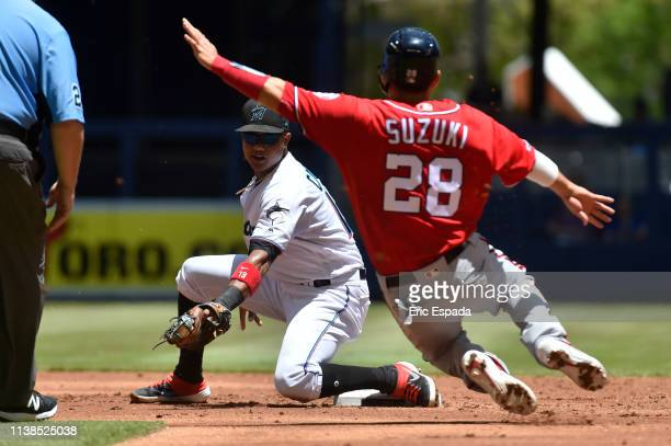 Starlin Castro of the Miami Marlins tags out Kurt Suzuki of the Washington Nationals as he attempts to steal second base during the second inning of...