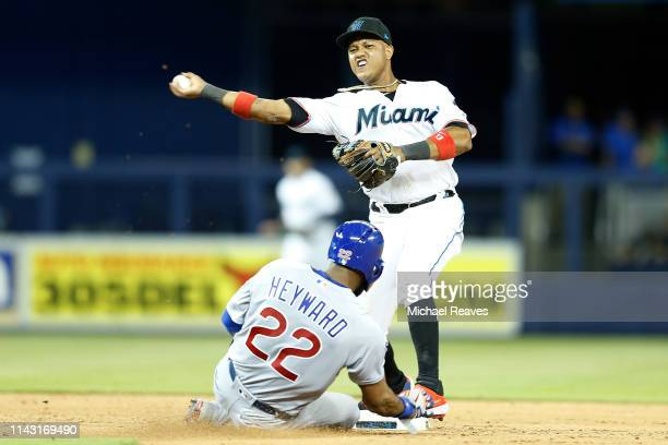 Starlin Castro of the Miami Marlins turns a double play as Jason Heyward of the Chicago Cubs slides into second base in the eighth inning at Marlins...