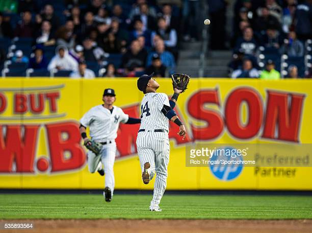 Starlin Castro of the New York Yankees attempts to catch a pop up during the game against the Kansas City Royals at Yankee Stadium on May 10 2016 in...