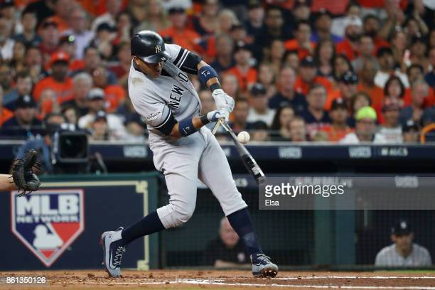 Starlin Castro of the New York Yankees breaks hit bat on a single in the second inning against the Houston Astros during game two of the American...