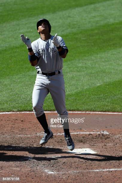 Starlin Castro of the New York Yankees celebrates after hitting a sixth inning solo home run against the Baltimore Orioles at Oriole Park at Camden...