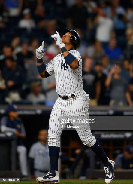 Starlin Castro of the New York Yankees celebrates his second inning home run against the Tampa Bay Rays at Yankee Stadium on September 26 2017 in the...