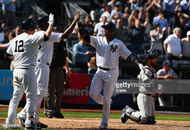 Starlin Castro of the New York Yankees celebrates his tworun home run in the eighth inning against the Tampa Bay Rays during the New York Yankees...