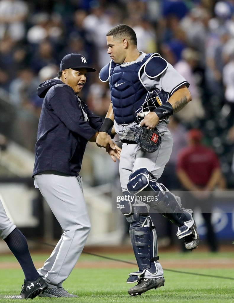 Starlin Castro #14 of the New York Yankees celebrates the 5-3 win over the New York Mets with teamamte Gary Sanchez #24 of the New York Yankees during interleague play on August 16, 2017 at Citi Field in the Flushing neighborhood of the Queens borough of New York City.