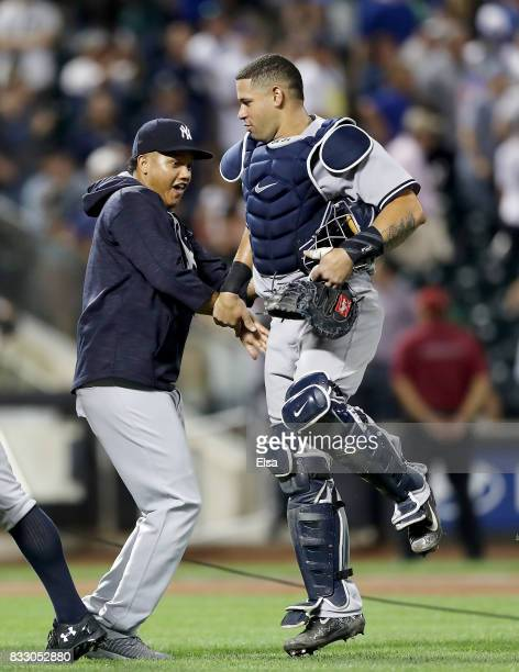 Starlin Castro of the New York Yankees celebrates the 53 win over the New York Mets with teamamte Gary Sanchez of the New York Yankees during...