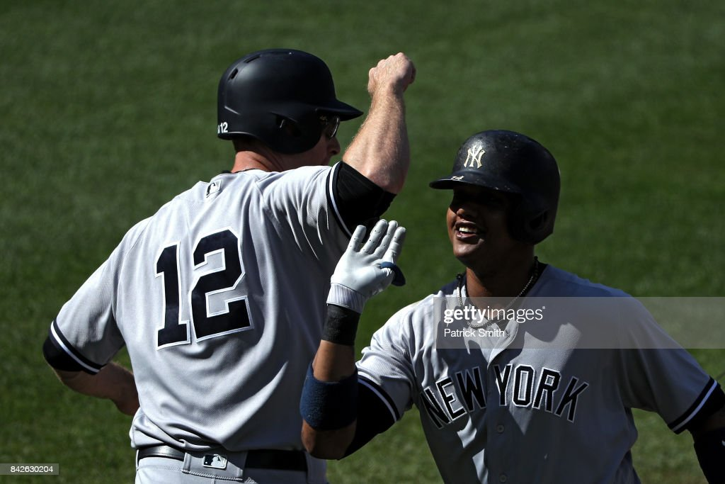 Starlin Castro #14 of the New York Yankees celebrates with teammate Chase Headley #12 after hitting a two run home run against the Baltimore Orioles during the fifth inning at Oriole Park at Camden Yards on September 4, 2017 in Baltimore, Maryland.