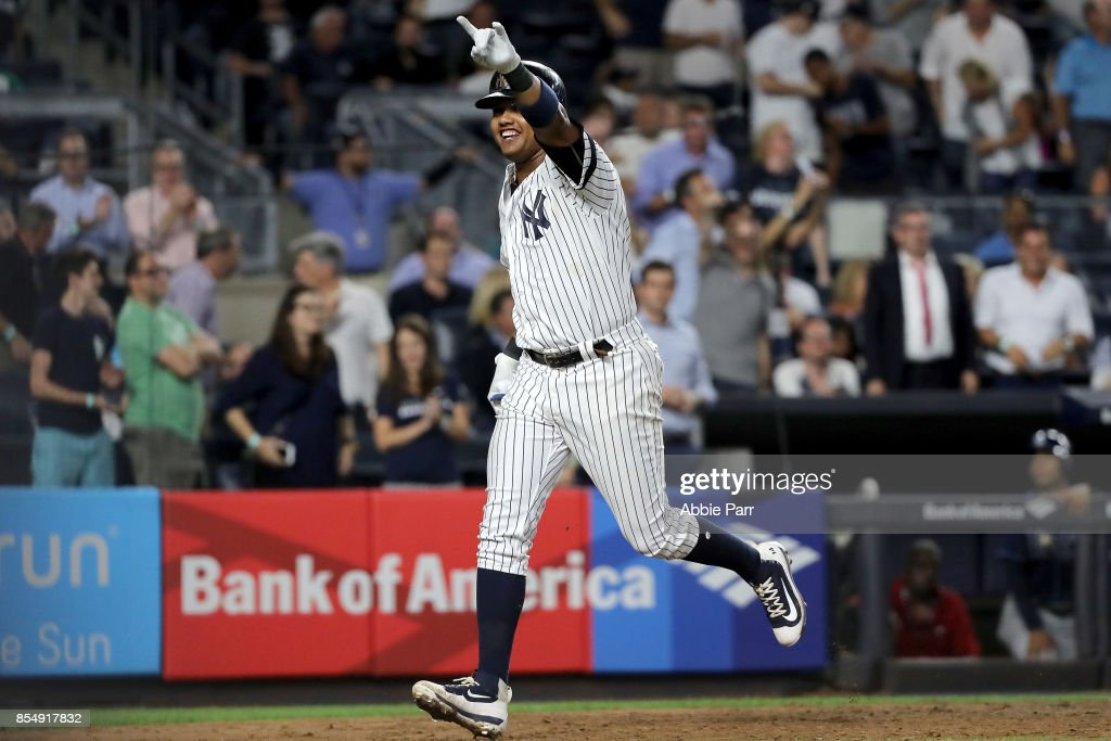 Starlin Castro #14 of the New York Yankees crosses home after hitting a solo home run in the sixth inning against the Tampa Bay Rays at Yankee Stadium on September 27, 2017 in the Bronx borough of New York City.