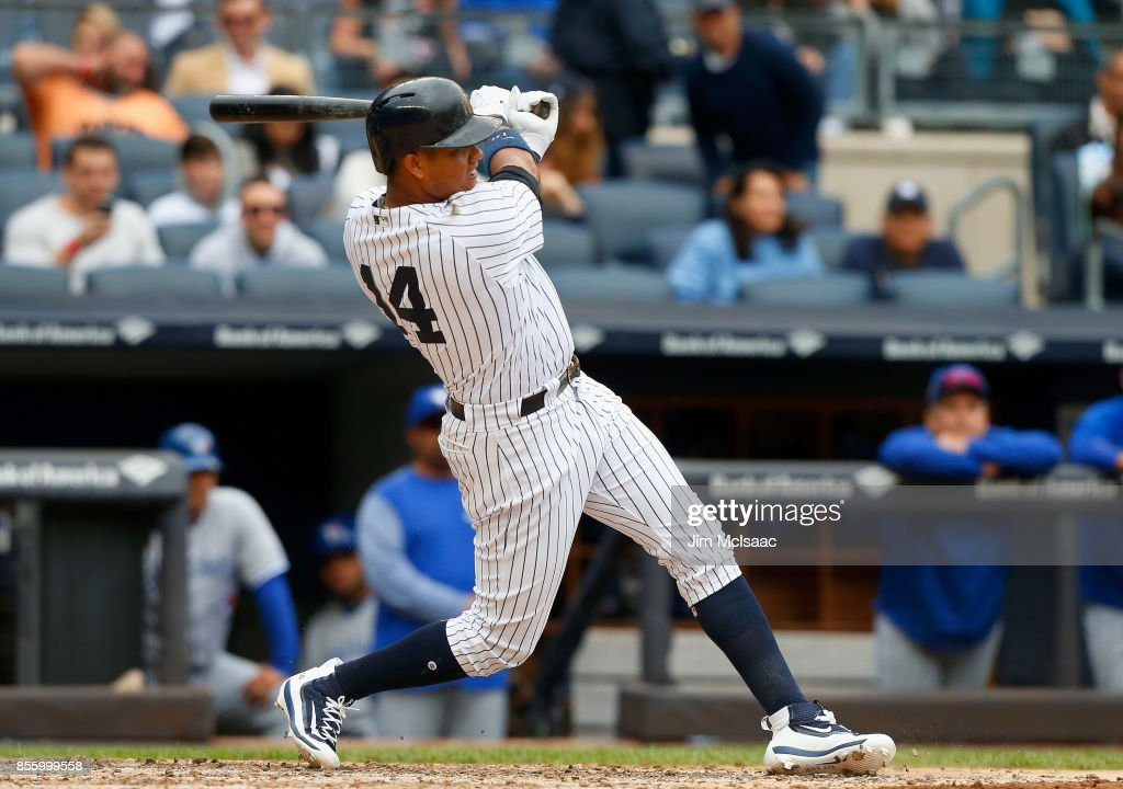 Starlin Castro #14 of the New York Yankees follows through on a fourth inning RBI single against the Toronto Blue Jays at Yankee Stadium on September 30, 2017 in the Bronx borough of New York City.