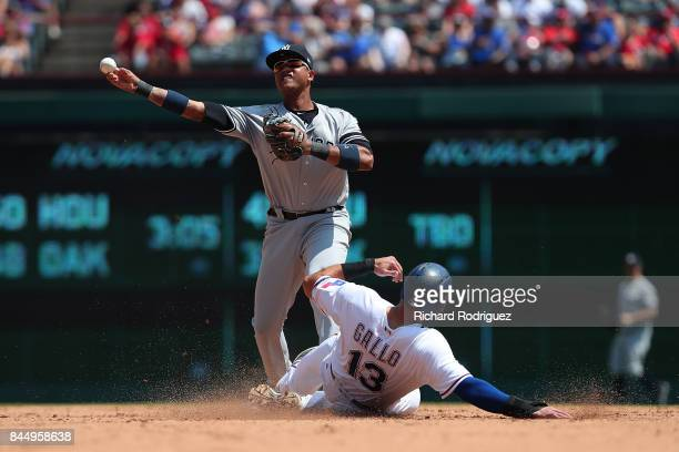 Starlin Castro of the New York Yankees forces out Joey Gallo of the Texas Rangers at second base as he makes the throw to first in the 5th inning at...
