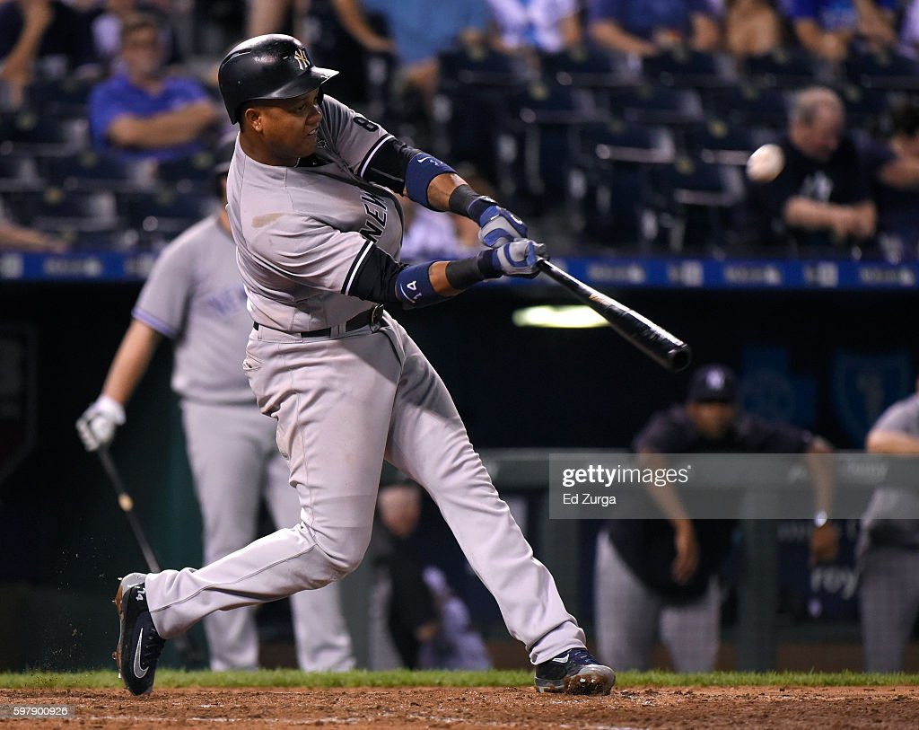Starlin Castro #14 of the New York Yankees hits a sacrifice fly in the eighth inning against the Kansas City Royals at Kauffman Stadium on August 29, 2016 in Kansas City, Missouri.