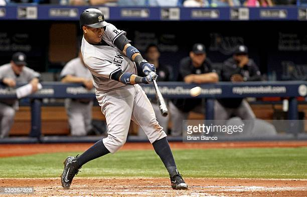 Starlin Castro of the New York Yankees hits a tworun home run off of pitcher Jake Odorizzi of the Tampa Bay Rays during the seventh inning of a game...