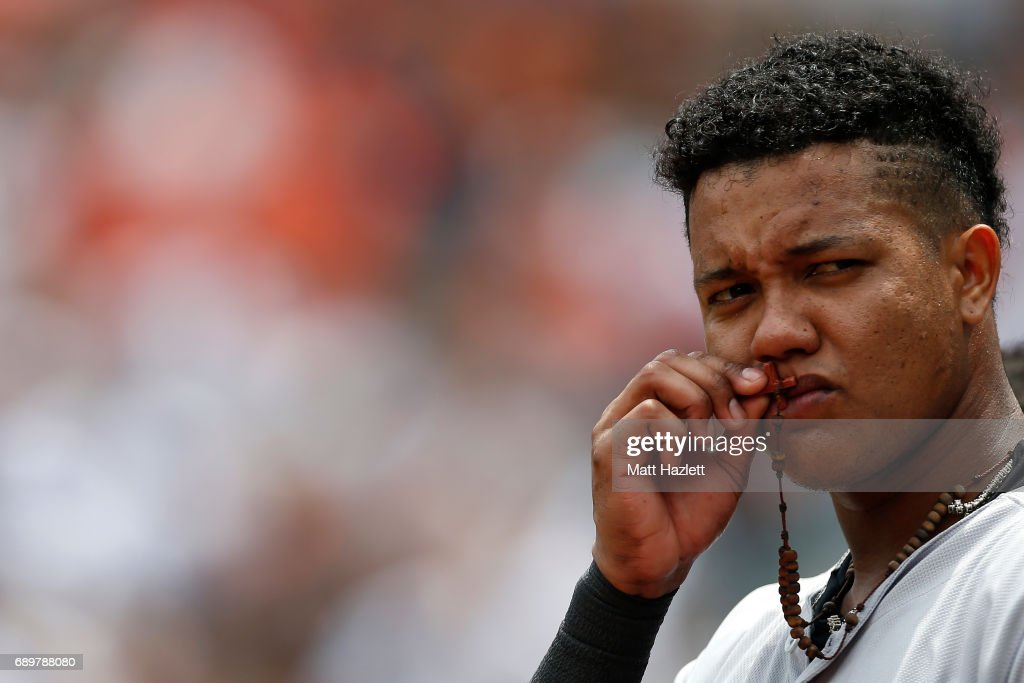 Starlin Castro #14 of the New York Yankees kisses a cross necklace prior to game against the Baltimore Orioles at Oriole Park at Camden Yards on May 29, 2017 in Baltimore, Maryland.