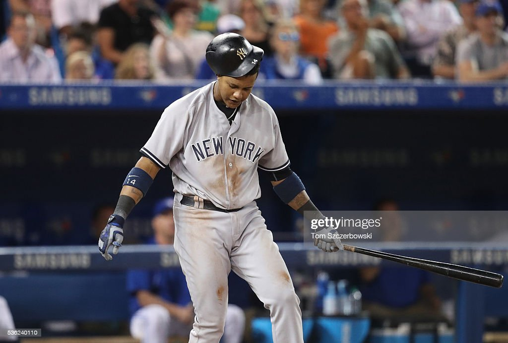 Starlin Castro #14 of the New York Yankees reacts after striking out in the ninth inning during MLB game action against the Toronto Blue Jays on May 31, 2016 at Rogers Centre in Toronto, Ontario, Canada.