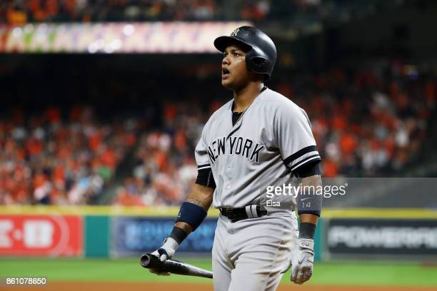 Starlin Castro of the New York Yankees reacts after striking out in the ninth inning against the Houston Astros during game one of the American...