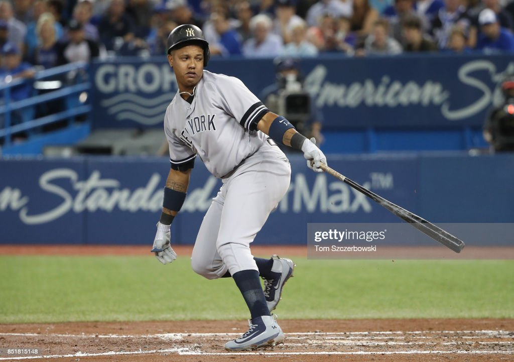 Starlin Castro #14 of the New York Yankees strikes out in the fourth inning during MLB game action against the Toronto Blue Jays at Rogers Centre on September 22, 2017 in Toronto, Canada.