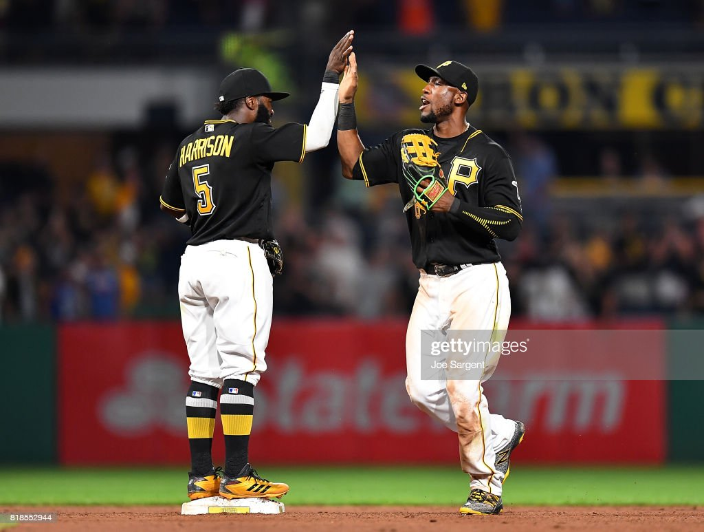 Starling Marte #6 and Josh Harrison #5 of the Pittsburgh Pirates celebrate after a 4-3 win over the Milwaukee Brewers at PNC Park on July 18, 2017 in Pittsburgh, Pennsylvania.