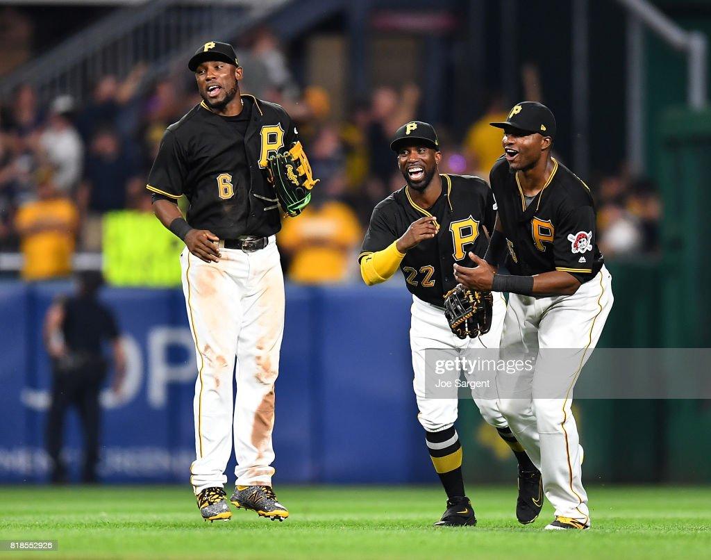 Starling Marte #6, Andrew McCutchen #22, and Gregory Polanco #25 of the Pittsburgh Pirates celebrate after a 4-3 win over the Milwaukee Brewers at PNC Park on July 18, 2017 in Pittsburgh, Pennsylvania.