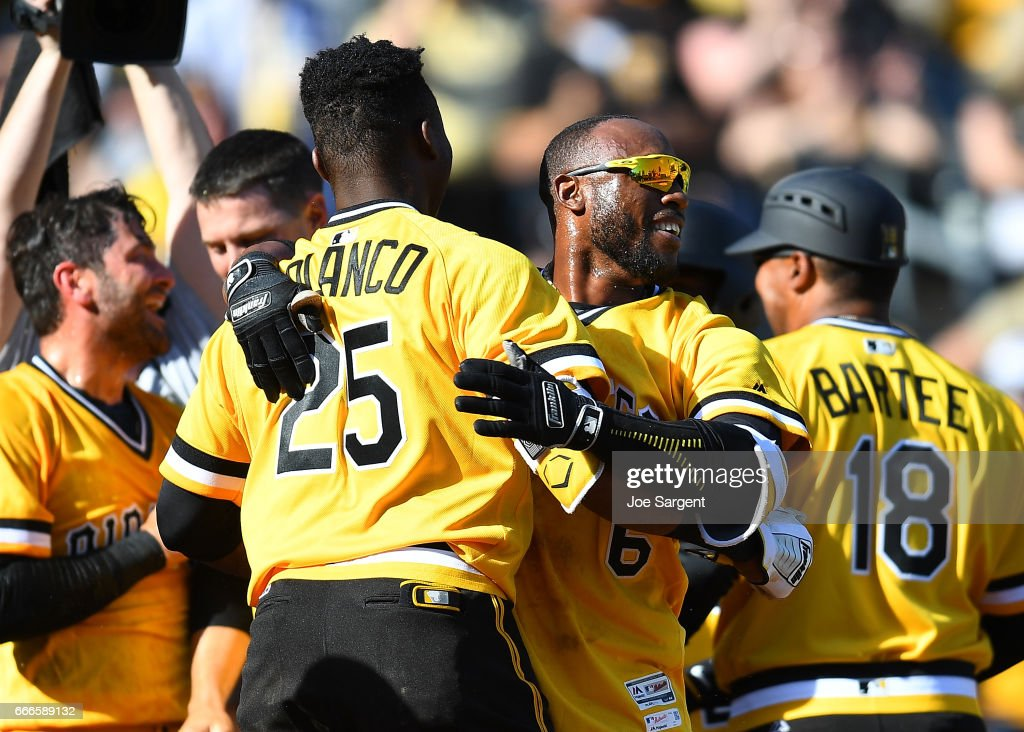 Starling Marte #6 celebrates his two run home run with Gregory Polanco #25 of the Pittsburgh Pirates during the tenth inning against the Atlanta Braves at PNC Park on April 9, 2017 in Pittsburgh, Pennsylvania. Pittsburgh won the game 6-5.