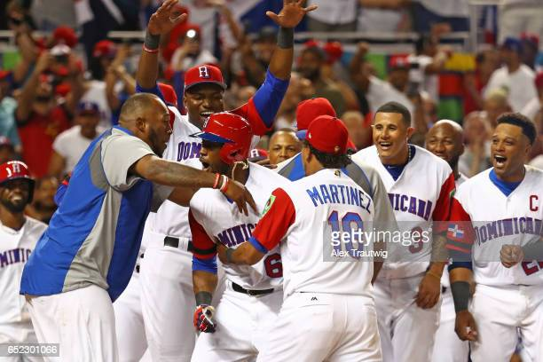 Starling Marte of Team Dominican Republic is greeted at home plate after hitting a solo home run in the during Game 4 Pool C of the 2017 World...