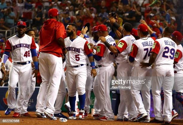 Starling Marte of Team Dominican Republic is greeted outside the dugout after scoring a run in the sixth inning during Game 4 Pool C of the 2017...
