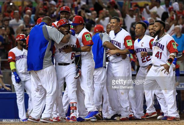 Starling Marte of the Dominican Republic is congratulated after hitting a solo home run during the eighth inning of a Pool C game of the 2017 World...