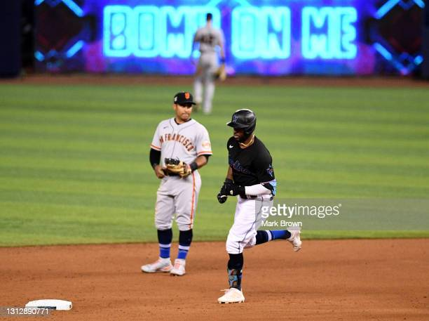 Starling Marte of the Miami Marlins runs the bases after hitting a three run home run in the eighth inning against the San Francisco Giants at...