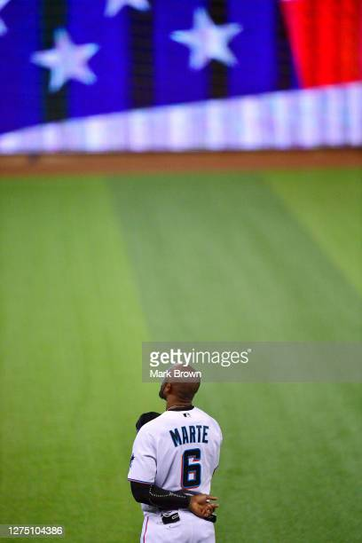 Starling Marte of the Miami Marlins stands during the National Anthem prior to the game against the Boston Red Sox at Marlins Park on September 17,...