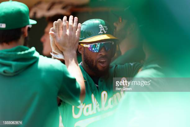 Starling Marte of the Oakland Athletics celebrates after scoring in the first inning against the Texas Rangers at RingCentral Coliseum on August 08,...