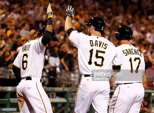 Starling Marte of the Pittsburgh Pirates and Gaby Sanchez celebrate with Ike Davis after hitting a three run home run in the eighth inning against...