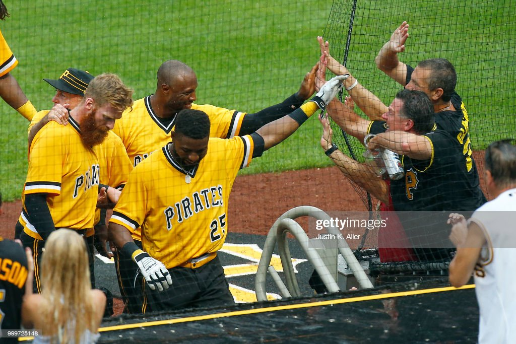 Starling Marte #6 of the Pittsburgh Pirates and Gregory Polanco #25 of the Pittsburgh Pirates celebrate with fans after a walk off win in the tenth inning against the Milwaukee Brewers at PNC Park on July 15, 2018 in Pittsburgh, Pennsylvania.