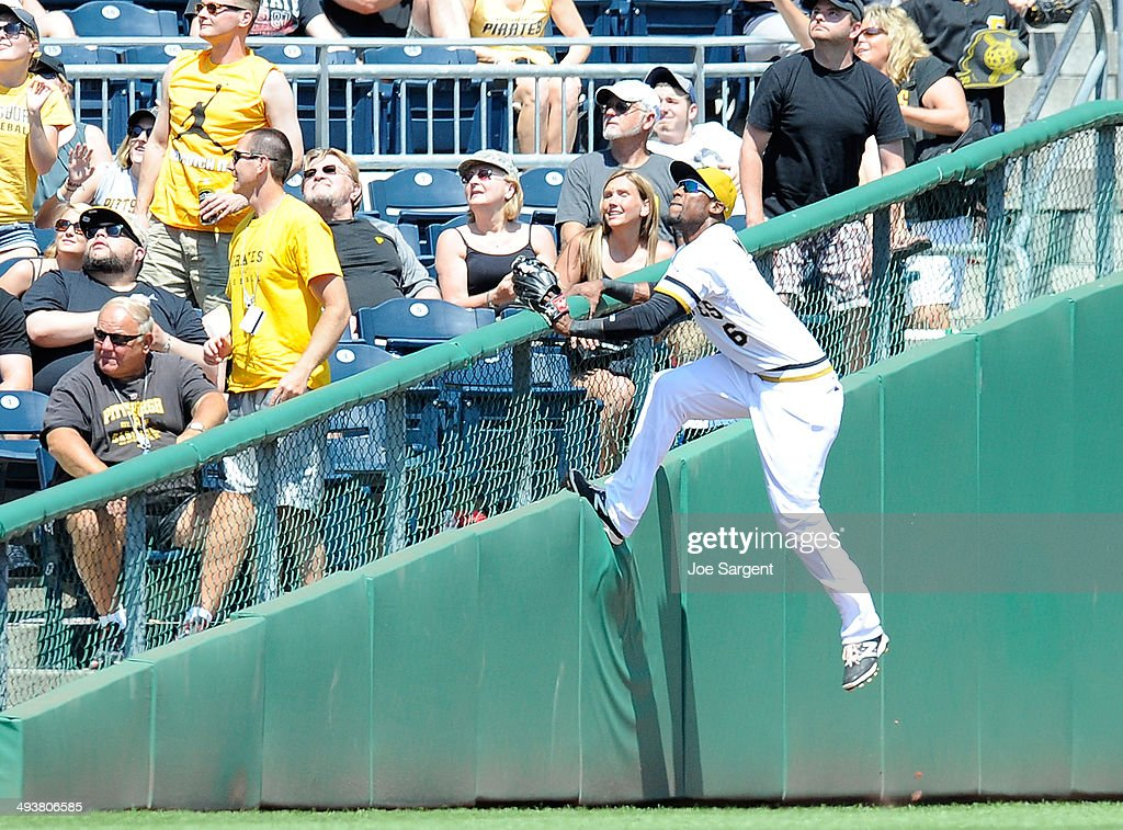 Starling Marte #6 of the Pittsburgh Pirates attempts to catch a foul ball during the fifth inning against the Washington Nationals on May 25, 2014 at PNC Park in Pittsburgh, Pennsylvania.