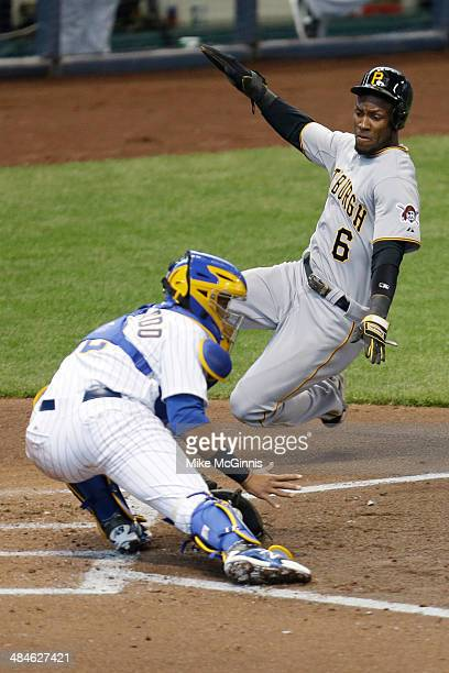 Starling Marte of the Pittsburgh Pirates beats the throw to Jonathan Lucroy of the Milwaukee Brewers during the top of the fourth inning at Miller...