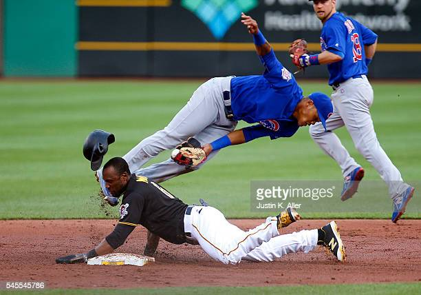 Starling Marte of the Pittsburgh Pirates breaks up the double play against Addison Russell of the Chicago Cubs in the second inning during the game...