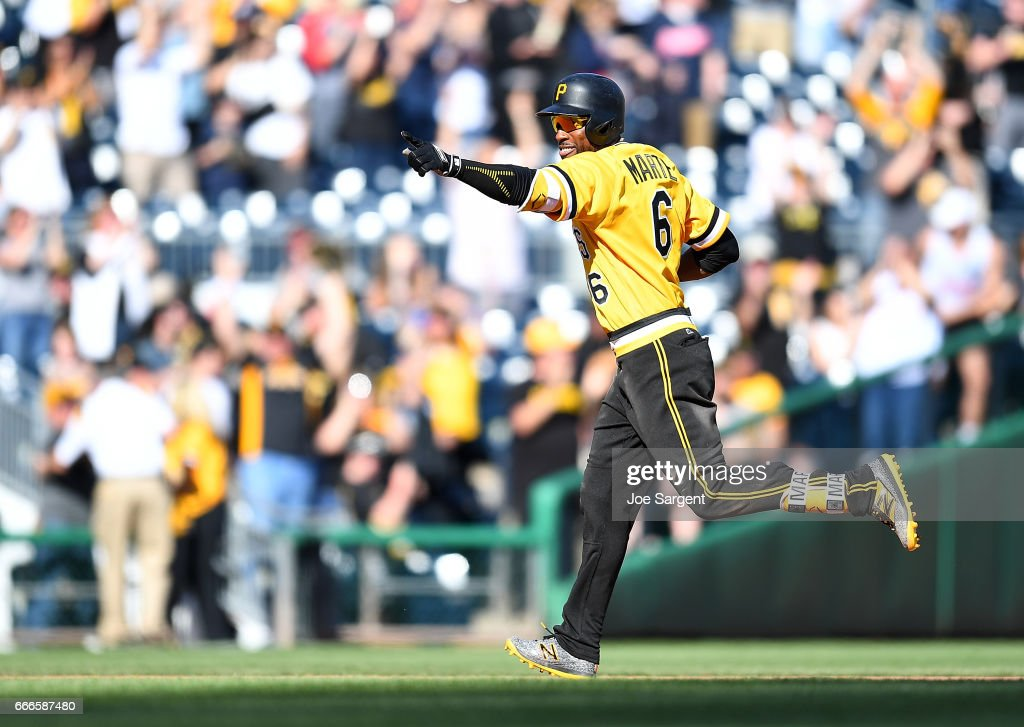 Starling Marte #6 of the Pittsburgh Pirates celebrates after hitting a two run home run during the tenth inning against the Atlanta Braves at PNC Park on April 9, 2017 in Pittsburgh, Pennsylvania. Pittsburgh won the game 6-5.