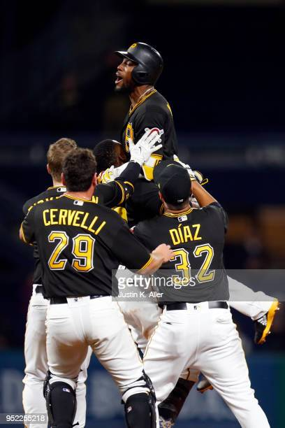 Starling Marte of the Pittsburgh Pirates celebrates after hitting a walk off single in the eleventh inning against the St Louis Cardinals at PNC Park...
