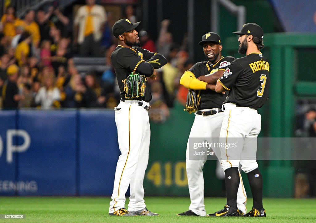 Starling Marte #6 of the Pittsburgh Pirates celebrates with Andrew McCutchen #22 and Sean Rodriguez #3 after the final out in their 6-3 win over the Detroit Tigers at PNC Park on August 8, 2017 in Pittsburgh, Pennsylvania.